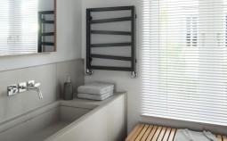 Полотенцесушитель для ванной: варианты размещения в маленьких помещениях