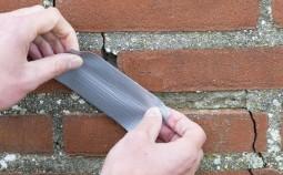 Правильный принцип устранения трещин в кирпичной стене