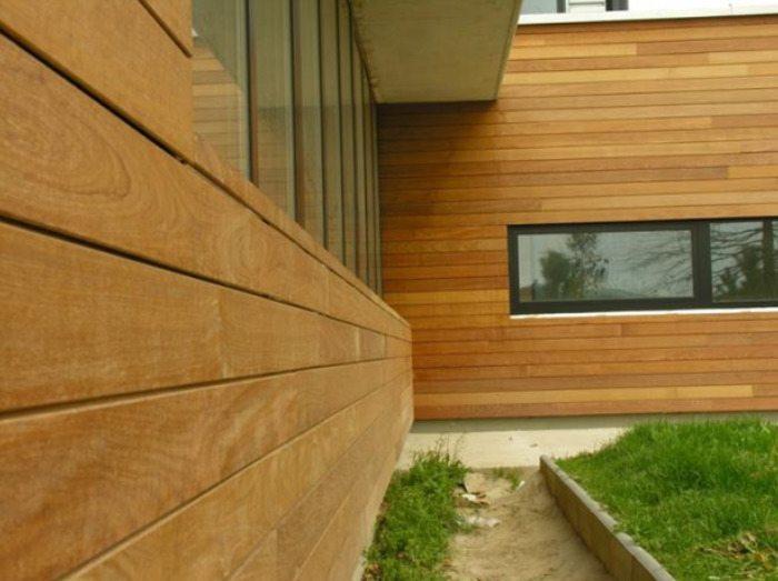 Чем обшить лучше дом из дерева